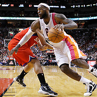 21 January 2012: Miami Heat small forward LeBron James (6) drives past Philadelphia Sixers shooting guard Evan Turner (12) during the Miami Heat 113-92 victory over the Philadelphia Sixers at the AmericanAirlines Arena, Miami, Florida, USA.