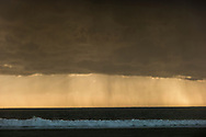 Rain falls from clouds off Venice Beach