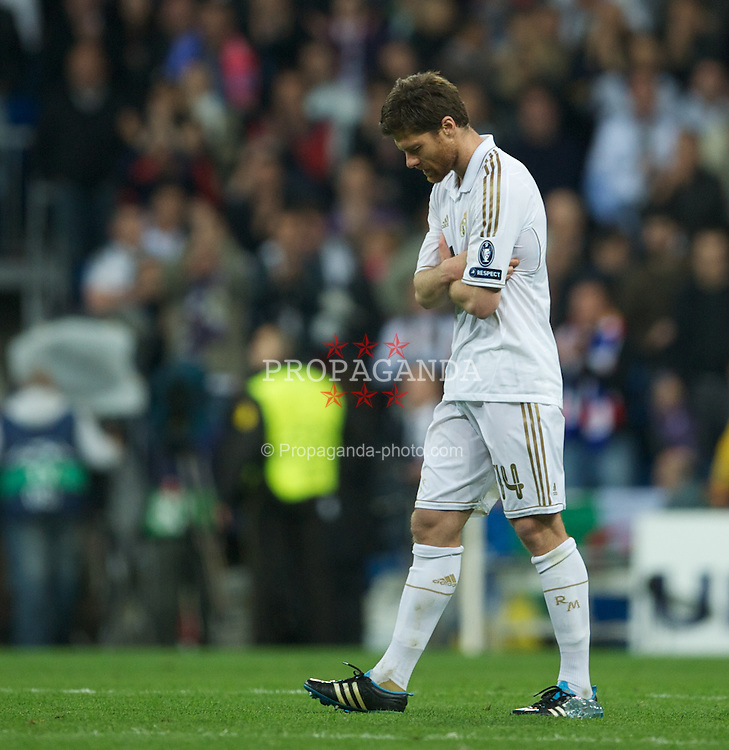 MADRID, SPAIN - Wednesday, April 25, 2012: Real Madrid's Xabi Alonso looks dejected after losing on penalties to Bayern Munchen during the UEFA Champions League Semi-Final 2nd Leg match at the Estadio Santiago Bernabeu. (Pic by David Rawcliffe/Propaganda)