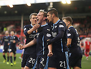 Gary Irvine is congratulated by Luka Tankulic and Jim McAlister after scoring Dundee's equaliser -  Aberdeen v Dundee, SPFL Premiership at Pittodrie<br />