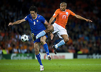 BERNE, SWITZERLAND - JUNE 09: Nigel de Jong of Netherlands and Luca Toni of Italy  during the Euro 2008 Group C match between Netherlands and Italy at Stade de Suisse Wankdorf on June 9, 2008 in Berne, Switzerland. (Photo by Manuel Queimadelos)