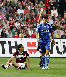 11.09.2010, AWD Arena, Hannover, GER, FBL, Hannover 96 vs Bayer Leverkusen, im Bild Michael Ballack (#13) bekommt nach dem Foul an Mohamed Abdellaoue (Hannover #25) die Gelbe Karte EXPA Pictures © 2010, PhotoCredit: EXPA/ nph/  Schrader+++++ ATTENTION - OUT OF GER +++++ / SPORTIDA PHOTO AGENCY