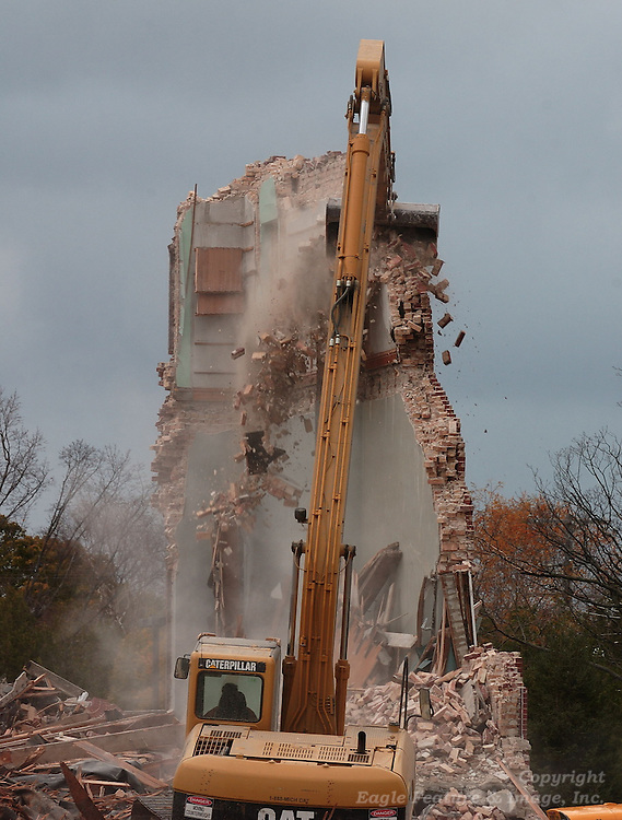 The last standing piece of wall of the Holy Childhood building in Harbor Springs is carefully torn down.