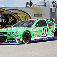 NASCAR Sprint Cup driver Danica Patrick drives her GoDaddy race car (10)  in the garage area during the NASCAR Coke Zero 400 Sprint practice session at the Daytona International Speedway on Thursday, July 4, 2013 in Daytona Beach, Florida.  (AP Photo/Alex Menendez)