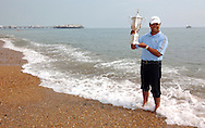 Michael CAMPBELL (NZ) at home on Brighton beach after winning his first major with the US Open trophy he won at Pinehurst,USA during summer at Brighton,East Sussex,England.