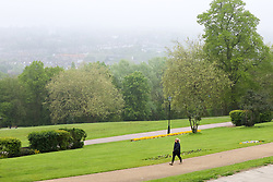 © Licensed to London News Pictures. 29/04/2019. London, UK. A woman walking in Alexandra Palace park as north London as early morning mist coats north London. Photo credit: Dinendra Haria/LNP