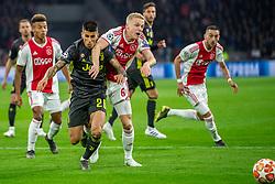 10-04-2019 NED: Champions League AFC Ajax - Juventus,  Amsterdam<br /> Round of 8, 1st leg / Ajax plays the first match 1-1 against Juventus during the UEFA Champions League first leg quarter-final football match / Joao Cancelo #20 of Juventus, Donny van de Beek #6 of Ajax