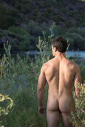 hot muscular naked man outdoors by a river