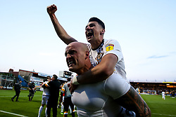 David Pipe and Regan Poole of Newport County celebrate after winning through to the Sky Bet League Two Playoff Final - Mandatory by-line: Robbie Stephenson/JMP - 12/05/2019 - FOOTBALL - One Call Stadium - Mansfield, England - Mansfield Town v Newport County - Sky Bet League Two Play-Off Semi-Final 2nd Leg