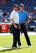 (L-R) Denver Broncos head coach John Fox talks to San Diego Chargers head coach Mike McCoy before the NFL week 15 regular season football game against the Denver Broncos on Sunday, Dec. 14, 2014 in San Diego. The Broncos won the game 22-10. ©Paul Anthony Spinelli