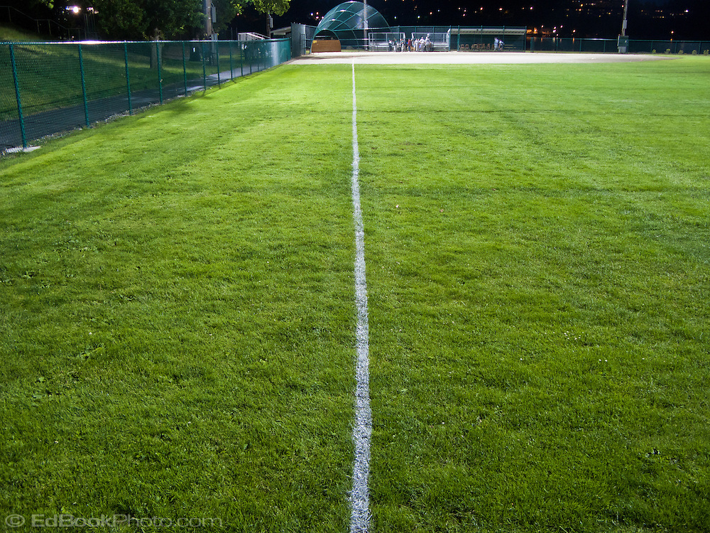 Baseball field first base foul line viewed from the outfield - Lions Field, Bremerton, Kitsap County, Washington, USA