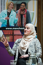 © Licensed to London News Pictures . 27/11/2014 . Manchester , UK . Chair of the Muslim Women's Sports Foundation , RIMLA AKHTAR , speaking at a public forum on Tackling Discrimination in Football , at Manchester University . The debate , sponsored by race equality think tank , The Runnymede Trust , addressed issues of racism and homophobia in soccer . Photo credit : Joel Goodman/LNP