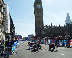 The vleaders in the mens wheelchair event in the London Olympics passing Big Ben April 21, 2013. Photo by: Max Nash / i-Images