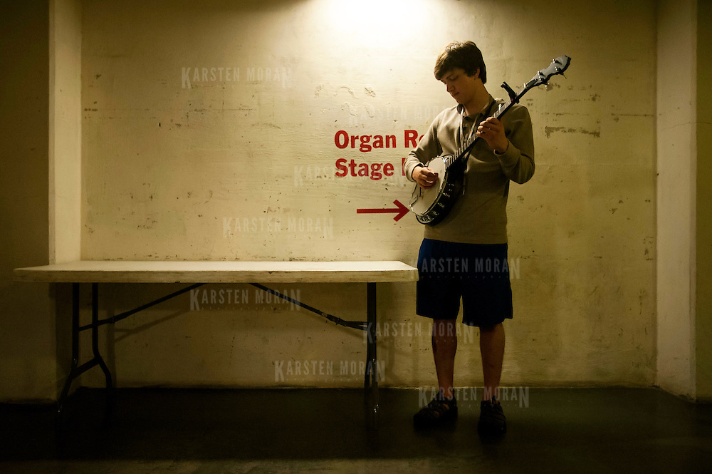 July 9, 2013 - Purchase, NY : Violinist Brendon Mezzetti, who is from Eagle River, AK, practices the banjo in the basement of the SUNY Purchase performing arts center on Tuesday afternoon. Mezzetti is a member of the National Youth Orchestra of the United States of America, which rehearsed with conductor Valery Gergiev at SUNY Purchase's Performing Arts Center in Westchester on Tuesday afternoon. The Orchestra, a new project of Carnegie Hall's Weill Music Institute, is comprised of musicians aged 16-19, hand-picked from across the country. The program -- and orchestra -- will kick off its inaugural season with a performance at SUNY Purchase on Thursday evening, and then head off to perform in Washington DC,  Moscow, St. Petersburg, and London.  CREDIT: Karsten Moran for The New York Times