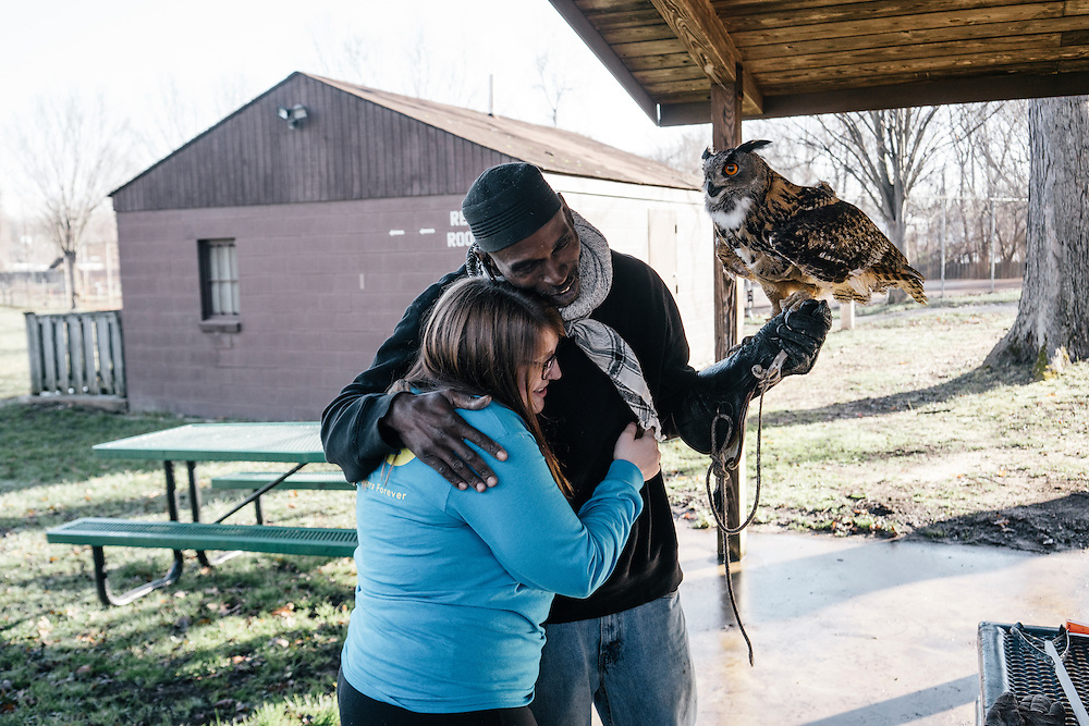 Claire Adamski, left, 21, from University of Minnesota Morris, thanks Rodney Stotts, executive director and raptor coordinator of Wings over America, after she held Hoots, the Eurasian eagle owl before the annual Lower Beaverdam Creek cleanup on March 17, 2016.
