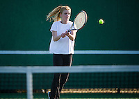 Gilford's Lindsey Corsack makes a forehand shot during her singles match with Interlakes Caitly Curran Wednesday afternoon.  (Karen Bobotas/for the Laconia Daily Sun)