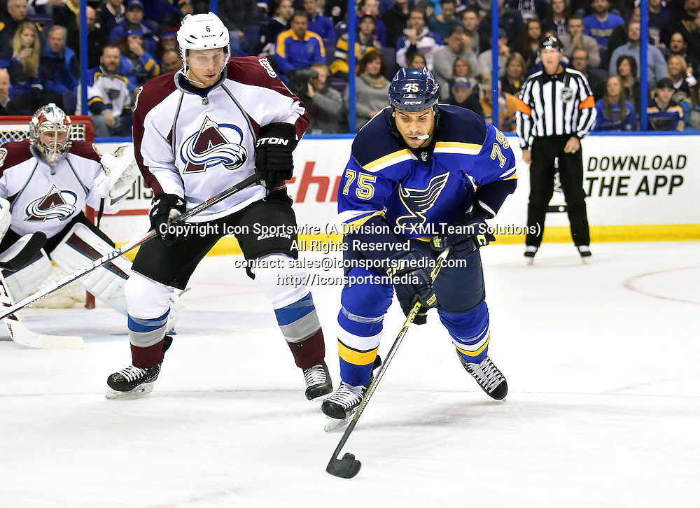 December 29, 2014: St. Louis Blues' rightwing Ryan Reaves (75) plays the puck ahead of Colorado Avalanche defenseman Nate Guenin (5) during an NHL game between the Colorado Avalanche and the St. Louis Blues at Scottrade Center in St. Louis.