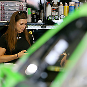 Danica Patrick, driver of the #7 GoDaddy Chevrolet is seen on her phone in the garage area during practice for the 60th Annual NASCAR Daytona 500 auto race at Daytona International Speedway on Friday, February 16, 2018 in Daytona Beach, Florida.  (Alex Menendez via AP)