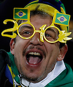 Brazilian supporter sings  during the 2010 FIFA World Cup South Africa Group G match between Brazil and North Korea at Ellis Park Stadium on June 15, 2010 in Johannesburg, South Africa.