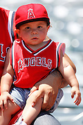 ANAHEIM, CA - JULY 21:  A young fan of the Los Angeles Angels of Anaheim of Anaheim wears team gear during the game against the Texas Rangers on Saturday, July 21, 2012 at Angel Stadium in Anaheim, California. The Rangers won the game 9-2. (Photo by Paul Spinelli/MLB Photos via Getty Images)