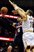 March 27, 2011; Cleveland, OH, USA; Atlanta Hawks guard Kirk Hinrich (6) shoots over Cleveland Cavaliers shooting guard Anthony Parker (18) during the fourth quarter at Quicken Loans Arena. The Hawks beat the Cavaliers 99-83. Mandatory Credit: Jason Miller-US PRESSWIRE