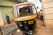 Shafiq Syed, 34, is driving his rickshaw from home to the city centre of Bangalore, Karnataka, India. Shaifq has been the main character of the Cannes' Camera D'Or 1988 winner Salaam Bombay, but after the movie he failed to become a star, fell back into poverty and lived on the streets for years before he became a rickshaw (tuk-tuk) driver in his home city of Bangalore, Karnataka State, India.
