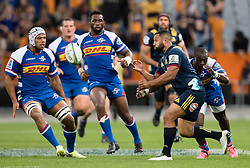 Highlanders' Lima Sopoaga, second right, delivers a pass against the Stormers in the Super Rugby match, Forsyth Barr Stadium, Dunedin, New Zealand, Friday, March 9, 2018. Credit:SNPA / Adam Binns ** NO ARCHIVING**