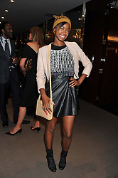 TOLULA ADEYEMI at the launch of Samsung's NX Smart Camera at charity auction with David Bailey in aid of Marie Curie Cancer Care at the Bulgari Hotel, 171 Knightsbridge, London on 14th May 2013.