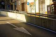 SANTANDER, SPAIN - April 18 2018 - Single person travelling up an outdoor street escalator or travelator in Santander, Spain, Europe.
