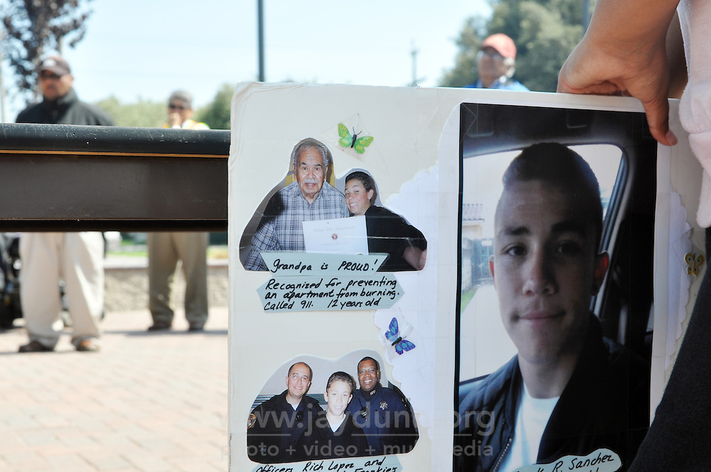 A poster in Closter Park on Tuesday commemorating the short life of Frank R. Sanchez, 16, a victim of gun violence. He was shot in the head while sitting in a car in his driveway on July 20th, 2010 in Salinas.
