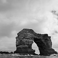 Ecuador, Galapagos Islands, Darwin Island, Waves crash against Darwin Arch
