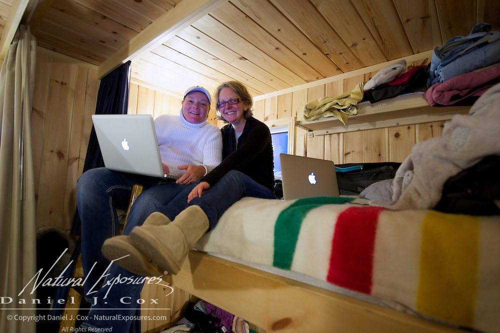 Nicky and Rachel checking out the days polar bear pictures in the bunkhouse known as Laperouse on the Tundra buggy Lodge. Cape Churchill 2012