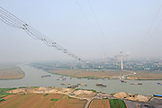 """HUAINAN, CHINA - JUNE 24: (CHINA OUT) <br /> <br /> Aerial Work For """"Anhui Power To Send The East"""" Project In Anhui<br /> <br /> A general view of wires on Huaishui River to eliminate equipment defects for the project of """"Anhui power to send the East"""" on June 24, 2014 in Huainan, Anhui province of China. <br /> ©Exclusivepix"""