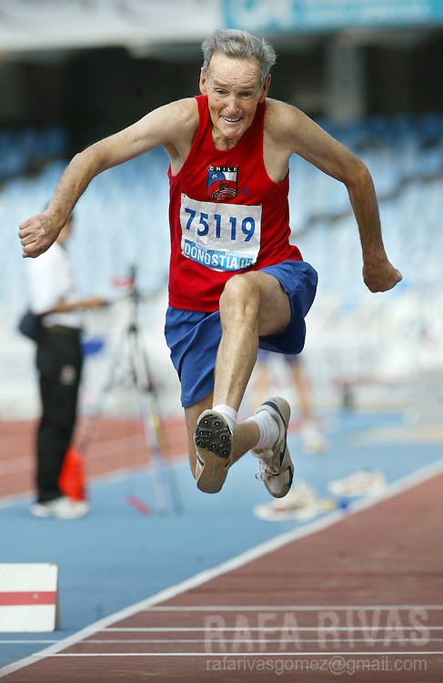 Chilean Ariel Standen, 76, vies in the triple jump final 29 August 2005 during the celebration of the XVI WMA World Master Athletics Championships Stadia 2005, in the northern Spanish Basque town of San Sebastian.