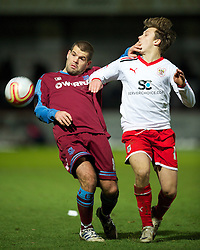 STEVENAGE, ENGLAND - Saturday, December 17, 2011: Tranmere Rovers' captain John Welsh in action against Stevenage's Luke Freeman during the Football League One match at Broadhall Way. (Pic by David Rawcliffe/Propaganda)