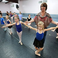 "Beth Richardson, with the North Mississippi Dance Centre, helps student Maynor Malone, 7, of Pontotoc, during the centre's ""Hope for the Holidays"" practice. The annual dance is a fundraiser for St. Jude."
