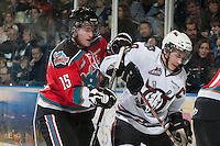 KELOWNA, CANADA - NOVEMBER 9:  Colton Sissons #15 of the Kelowna Rockets checks Turner Elson #10 of the Red Deer Rebels at the Kelowna Rockets on November 9, 2012 at Prospera Place in Kelowna, British Columbia, Canada (Photo by Marissa Baecker/Shoot the Breeze) *** Local Caption ***