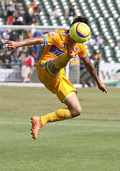 July 8, 2018 - Round Rock, USA - Tigres forward Lucas Zolarayan (8) elevates to kick the ball  during a Liga MX friendly match between Tigres and Pachuca at Dell Diamond in Round Rock, Texas, on July 8, 2018. (Credit Image: © Scott W. Coleman via ZUMA Wire)