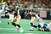 Running Back Marshall Faulk (28) of the St. Louis Rams gets tackled by the Carolina Panthers defense during a 48 to 14 win by the Rams on 11/11/2001..©Wesley Hitt/NFL Photos