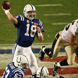 2010 February 07: Indianapolis Colts quarterback Peyton Manning (18) throws the ball during a 31-17 win by the New Orleans Saints over the Indianapolis Colts in Super Bowl XLIV at Sun Life Stadium in Miami, Florida.