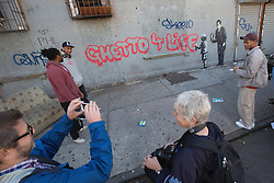 "Banksy graffiti art in New York City. Monday 21st October 2013. Graffiti artist Banksy's new piece in the South Bronx, ""Ghetto 4 Life."" The blue graffiti tags were later added by other graffiti artists. Banksy is releasing one piece per day for the month of October as part of his ""Better Out Than In' artist residency on the streets of New York. Picture by Michael Graae / i-Images"