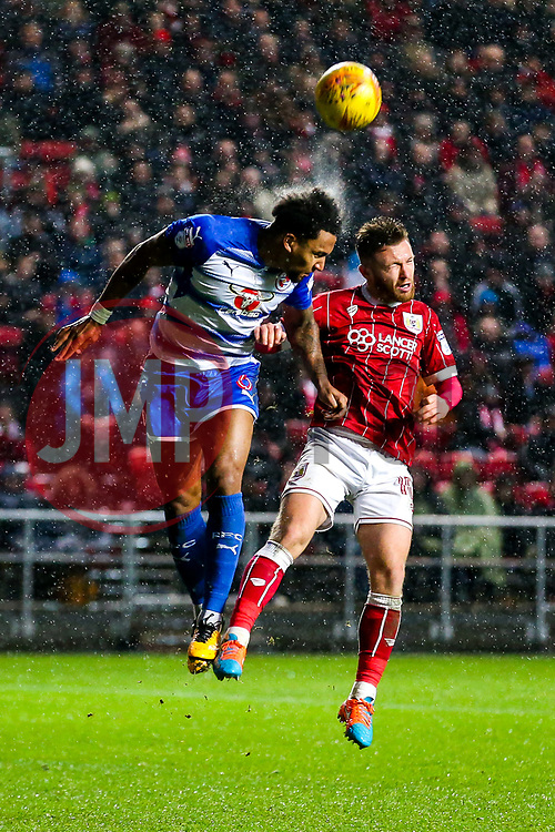 Liam Moore of Reading and Matt Taylor of Bristol City compete for the ball - Rogan/JMP - 26/12/2017 - Ashton Gate Stadium - Bristol, England - Bristol City v Reading - Sky Bet Championship.