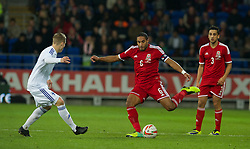 CARDIFF, WALES - Saturday, November 16, 2013: Wales' captain Ashley Williams in action against Finland during the International Friendly match at the Cardiff City Stadium. (Pic by David Rawcliffe/Propaganda)