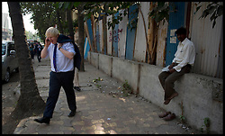 London Mayor Boris Johnson on his phone after playing cricket with children on Juhu beach in Mumbai, on the fifth day of his 6 day tour of India, Thursday November 29, 2012. Photo by Andrew Parsons / i-Images