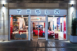 Tesla showroom at night on Multrees Avenue in Edinburgh, Scotland, United Kingdom