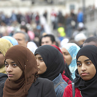 Young muslim women  wearing hijab in the crowd, Eid in the Square, Trafalgar Square, London, England<br />