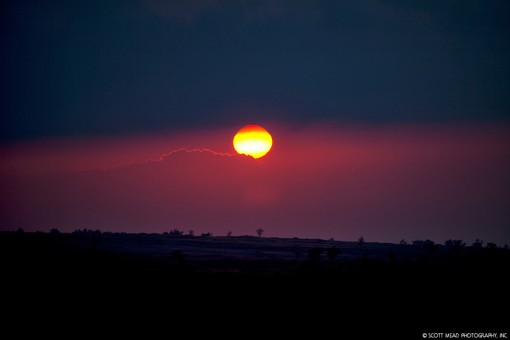 Setting sun at sunset on Big Island, Hawaii