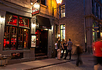 Editorial Travel Photography: People discussing near Le Piano Rouge bar and lounge, Old Montreal, Quebec, Canada