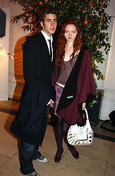 A party hosted by Mario Testino, Bianca Jagger and Kenneth Cole in collaboration with UNFPA and Marie Stopes International to celebrate the publication of Women to Woman: Positively Speaking - a book to raise awareness of women living with HIV/Aids, held at The Orangery, Kensington Palace, London on 2nd December 2004.<br />Picture shows:-Model LILY COLE and OLIVER JACKSON.<br /><br />NON EXCLUSIVE - WORLD RIGHTS