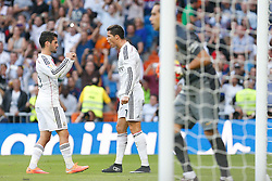 25.10.2014, Estadio Santiago Bernabeu, Madrid, ESP, Primera Division, Real Madrid vs FC Barcelona, 9. Runde, im Bild Real Madrid&acute;s Cristiano Ronaldo celebrates a goal with Isco // during the Spanish Primera Division 9th round match between Real Madrid CF and FC Barcelona at the Estadio Santiago Bernabeu in Madrid, Spain on 2014/10/25. EXPA Pictures &copy; 2014, PhotoCredit: EXPA/ Alterphotos/ Victor Blanco<br /> <br /> *****ATTENTION - OUT of ESP, SUI*****